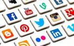 Logos from social media companies on a keyboard to represent a Social Media Portfolio